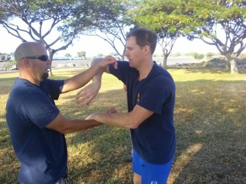 Scott Cannam and Mike Pollard work Chi Sao technique in Kailua Kona, Hawaii